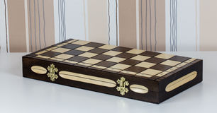 Chess board on a white table Stock Image