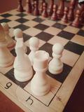 Chess board. whites start and win royalty free stock image