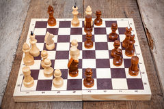 Chess board with wooden figures Royalty Free Stock Photo