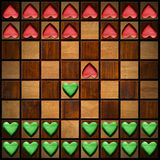 Chess Board with Wooden Hearts Royalty Free Stock Images