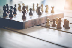 Chess board on wooden table Royalty Free Stock Photography