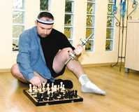 Chess or body building ? Royalty Free Stock Photos