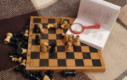 Chess and a book Stock Photos