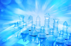 Chess Business Strategy. A chessboard and chess pieces set up for play with blue tones and light rays Royalty Free Stock Images