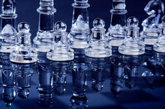 Chess bussiness concept of victory. Chess figures in a reflection of chessboard. Stock Photography