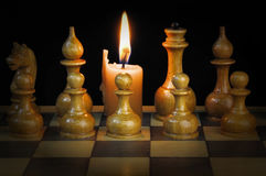 Chess and candle Stock Images