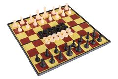 Chess and checkers on a brown chessboard, on a white background, isolate. Board game stock image