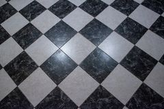 Chess checkers marble floor stock photography
