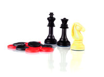 Chess and Checkers whith reflection on a white Royalty Free Stock Photography