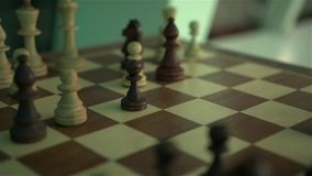 Chess on the chess board. At evening dark night scene with camera movement shot in slow motion with dynamic color of light stock video