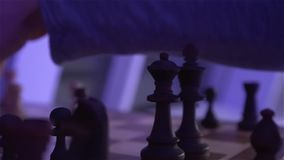 The Chess On Chess Board. At evening dark night scene with camera movement shot in slow motion with dynamic color of light stock video