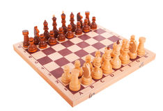 Chess on a chess board isolated over white Stock Images