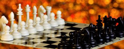 Chess on the chessboard, competition and winning strategy. Chess is a popular ancient Board logic antagonistic game with special. Black and white pieces, on a stock image