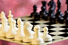Chess on the chessboard, competition and winning strategy. Chess is a popular ancient Board logic antagonistic game with special. Black and white pieces, on a royalty free stock photos