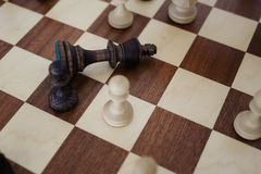 Chess on the chessboard. Сheck mate a king Royalty Free Stock Photos