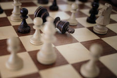 Chess on the chessboard. Сheck mate a king Royalty Free Stock Image