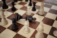 Chess on the chessboard. Сheck mate a king Royalty Free Stock Images