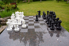 Chess and chessboard in ranch yard Stock Photo