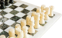 Chess and chessboard. White and green chess and chessboard, with focus on white king and queen stock photos