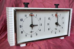 Chess clock. Old chess clock on a background of pink fabric Royalty Free Stock Image