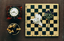 Chess, clock and seashell Royalty Free Stock Photo