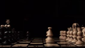 Chess closeup, wooden chess board, business concept, black background. slide camera. Studio. Hand made chess stock footage