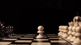 Chess closeup, wooden chess board, business concept, black background. slide camera. Studio. Chess player makes the first move white pawn. chess closeup, wooden stock footage