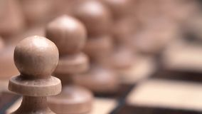 Chess closeup, wooden chess board, business concept, black background. slide camera. Studio. Rows of pawns macro. chess closeup, wooden chess board, business stock footage