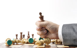 Chess competition. Fist with chess king Stock Images