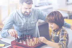 Chess competition between father and his little son Royalty Free Stock Photos