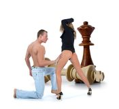 Chess composition with girl and man Royalty Free Stock Image