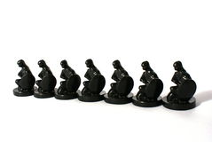 Chess concept of equality. Row of chess figures isolated on white background Royalty Free Stock Photo