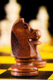 Chess concept with pieces. On the board Royalty Free Stock Images