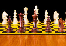 Chess concept with pieces  `. Chess concept with pieces on the board Stock Photos