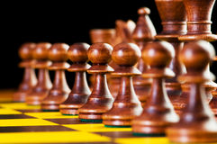 Chess concept with pieces. On the board Stock Photography