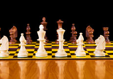 Chess concept with pieces on the board. Chess concept with pieces on the chess board Stock Photo