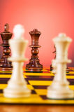 Chess concept with pieces on the board. Chess concept with pieces on the chess board Stock Photos