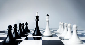 Chess conference. Conference metaphor in chess pieces having deal Royalty Free Stock Images