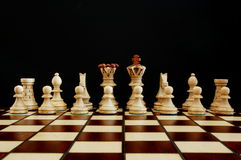 Chess conflict. Chess pieces showing concept of conflict power and success stock photo