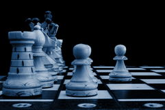 Chess conflict. Chess pieces showing concept of conflict power and success stock images