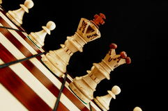 Chess conflict. Chess pieces showing concept of conflict power and success stock photography