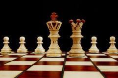Chess conflict. Chess pieces showing concept of conflict power and success Royalty Free Stock Photography