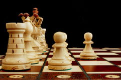 Chess conflict. Chess pieces showing concept of conflict power and success royalty free stock photo
