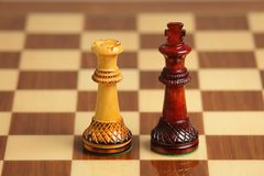 Chess couple. Of interracial love Royalty Free Stock Photo