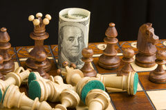 Chess and dollar. Money on chess board concept business background Stock Images