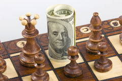 Chess and dollar. Money on chess board concept business background Stock Photography