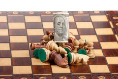Chess and dollar Stock Image
