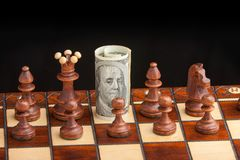 Chess and dollar Royalty Free Stock Image
