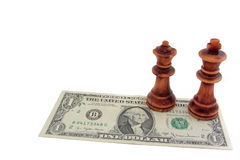 Chess and dollar: Dark king and queen on one US dollar bill. Dark king and queen on one US dollar bill Royalty Free Stock Image