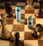Chess with the dollar and euro bank note. Dollar Royalty Free Stock Image